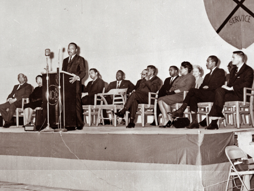 Dr. Martin Luther King speaking on a stage at NC Central University