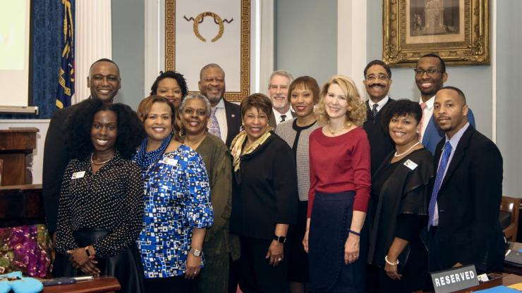African American Heritage Commission staff and commissioners, with First Lady Kristin Cooper and Justice Michael Morgan