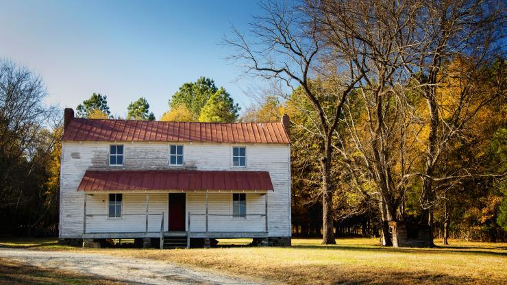 old white house with red tin roof at Stagville