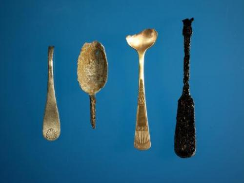 Conserved spoons made of different metals from the Thomas Wolfe cistern.