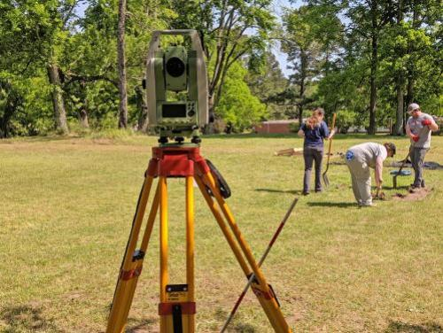 Total station and archaeologists