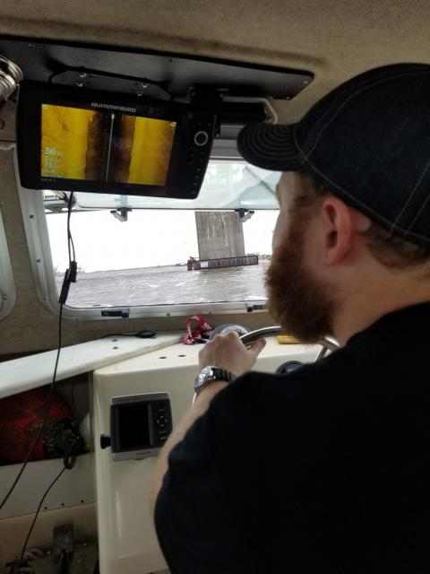 OSA archaeologist using side scan sonar