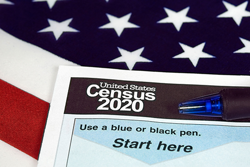 2020 Census form with American flag behind it