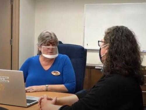 image of clear mask use at closing home meeting