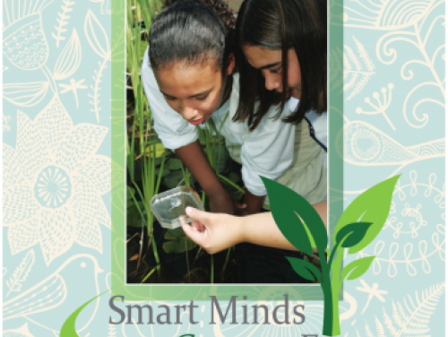cover of Evironmental Literacy Plan showing 2 young girls examining an insect