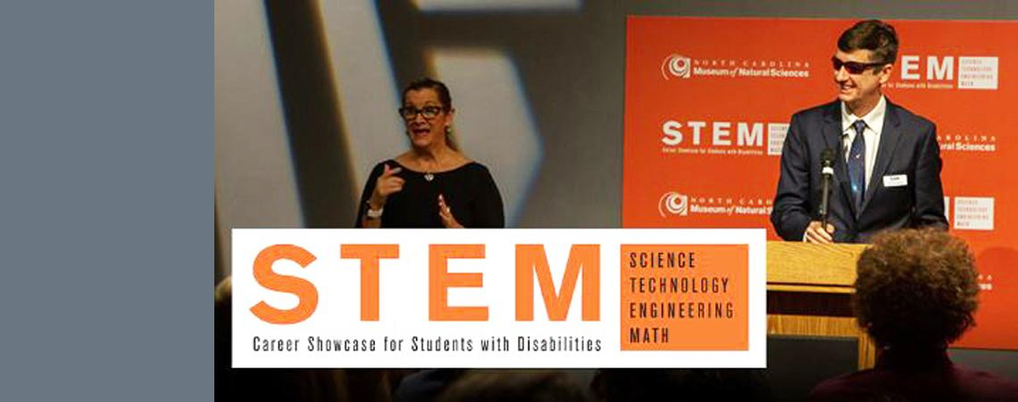 photo of a Ed Summers and sign language translator at the 2019 STEM Showcase for students with disabilities