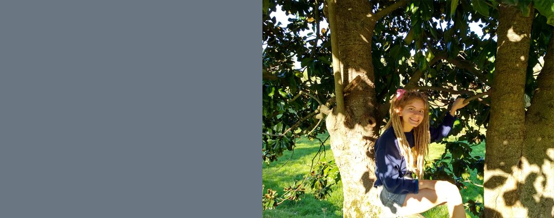 photo of Julie Neumark in a tree