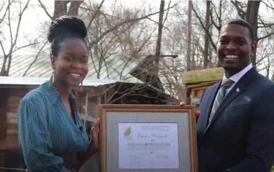 Secretary Regan presenting EE Certificate