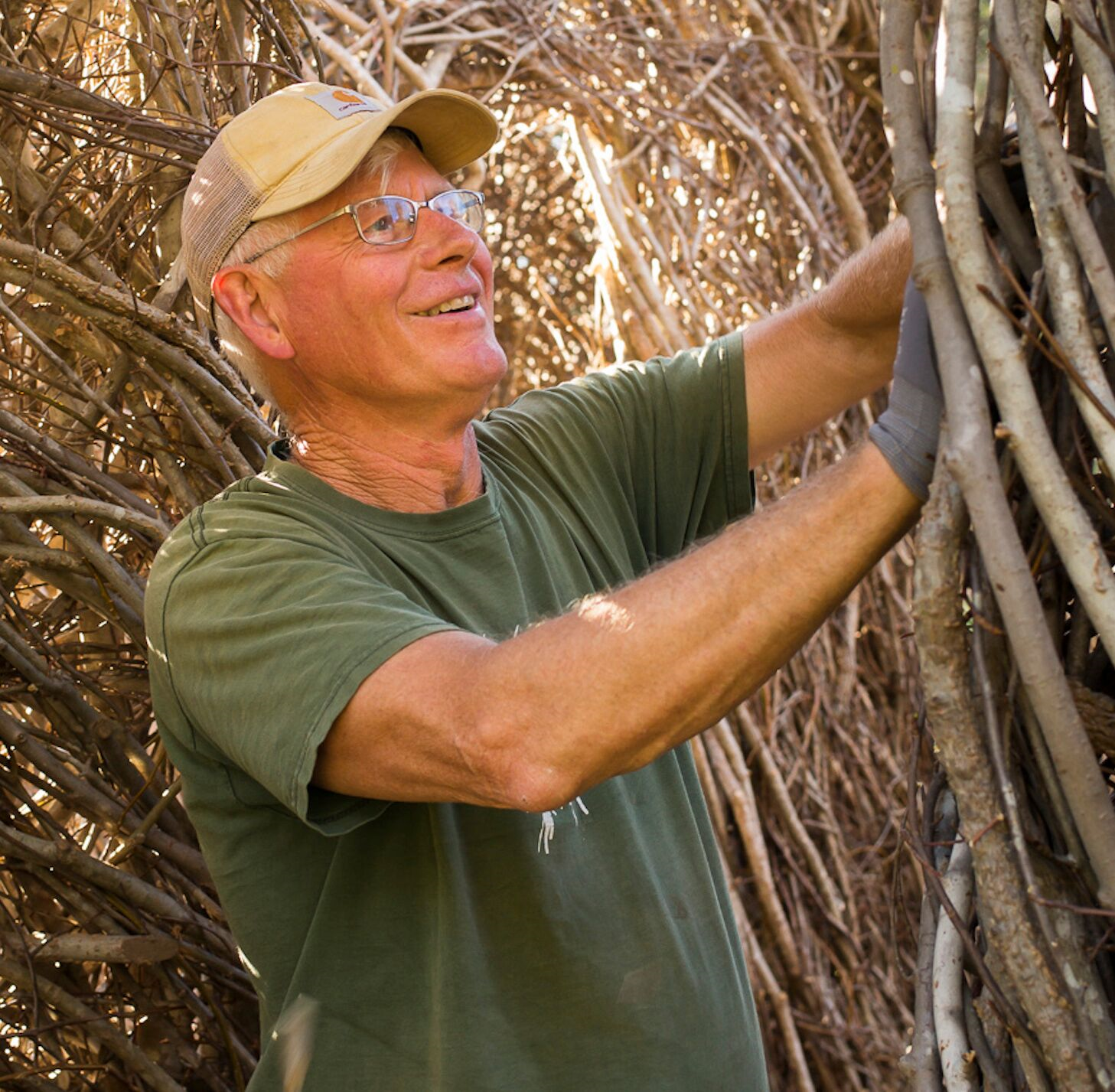 Patrick Dougherty working on stick scuplture