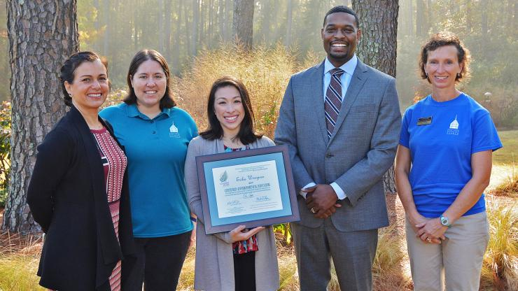 Secretary Regan awards certificate to educator at Cape Fear Botanical Garden