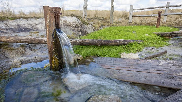 groundwater pouring out of a pump