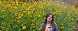 Young woman in a field of yellow flowers