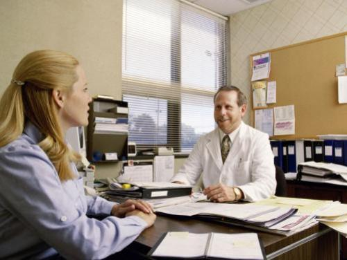 Doctor meeting with patient