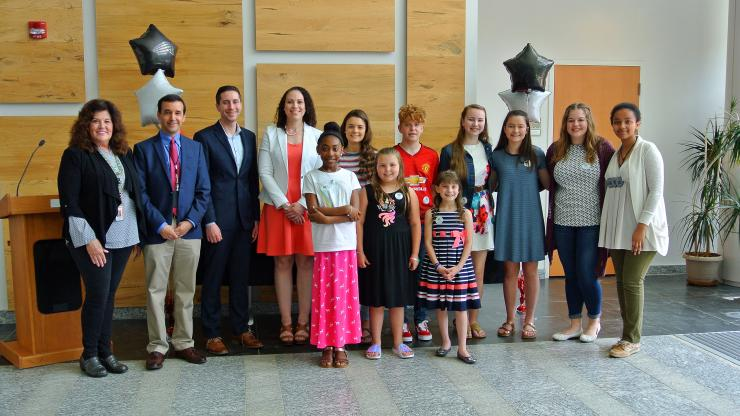 """""""Fight the Bite"""" poster contest winners with DHHS leaders."""