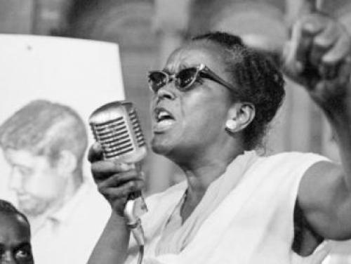 Ella Baker speaking with a microphone