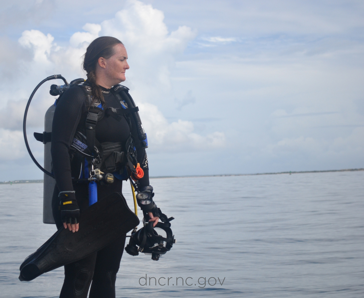 NC OSA underwater archaeologist Kim prepares for a shipwreck dive.