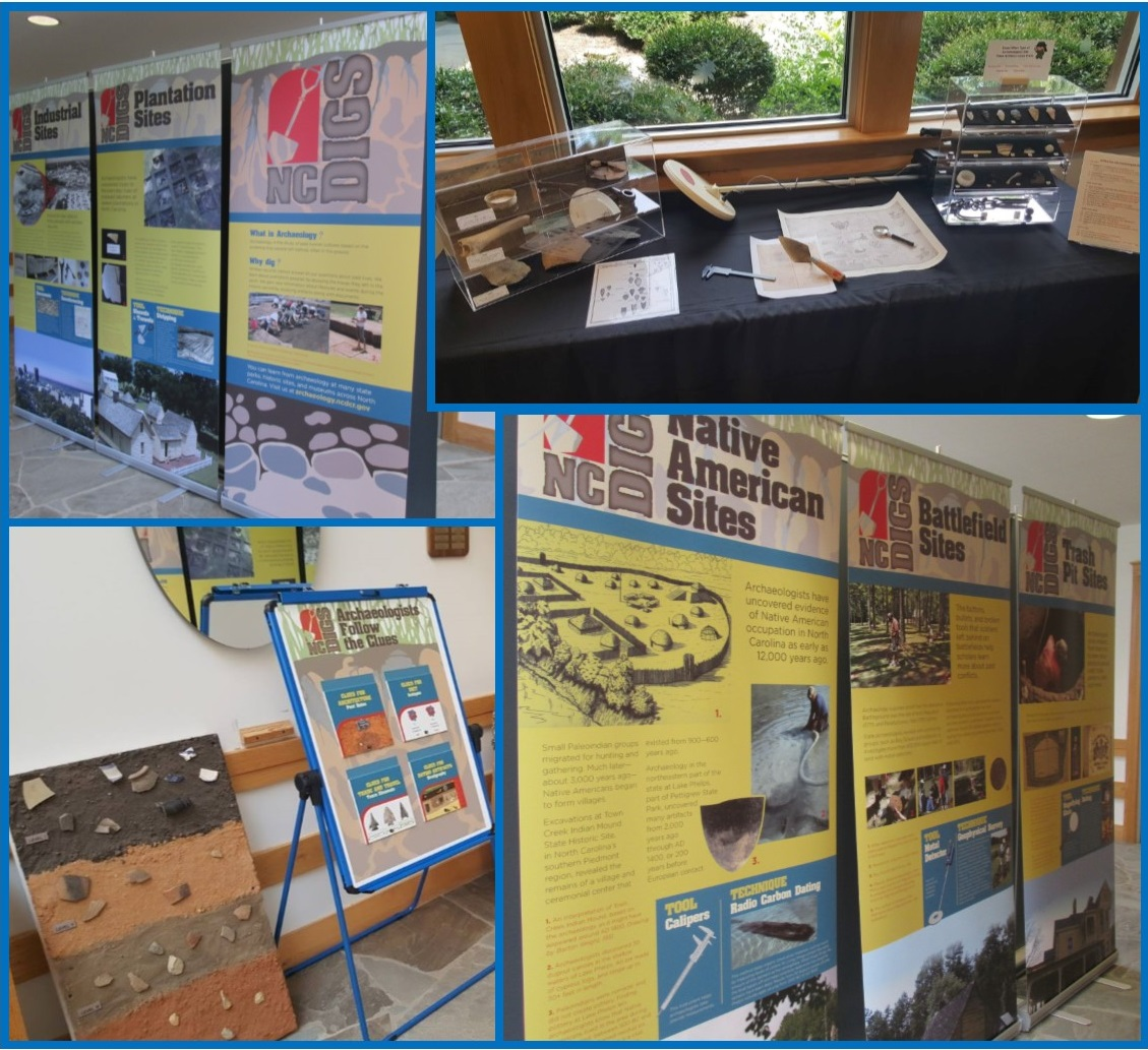 Traveling exhibit set up at Yates Mill: three info panels about site types; tools used by archaeologists and artifacts; soil stratigraphy; three panels on site type
