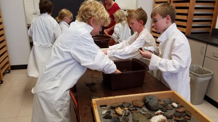 Kids washing artifacts at OSARC