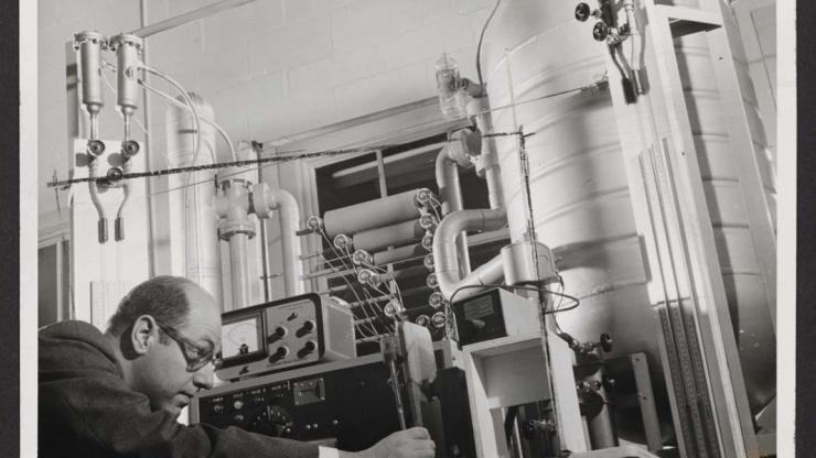 Photo from a grant file showing a man working with a piece of equipment