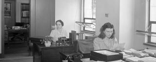 Mary Rogers and Julia Meconnahey sorting through materials in the Dept. of Archives and Records ca. 1944