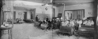 Falling Creek High School, Wayne County, NC, ca 1910. Pictured is an interior view of a multi-room rural school house with classes underway.