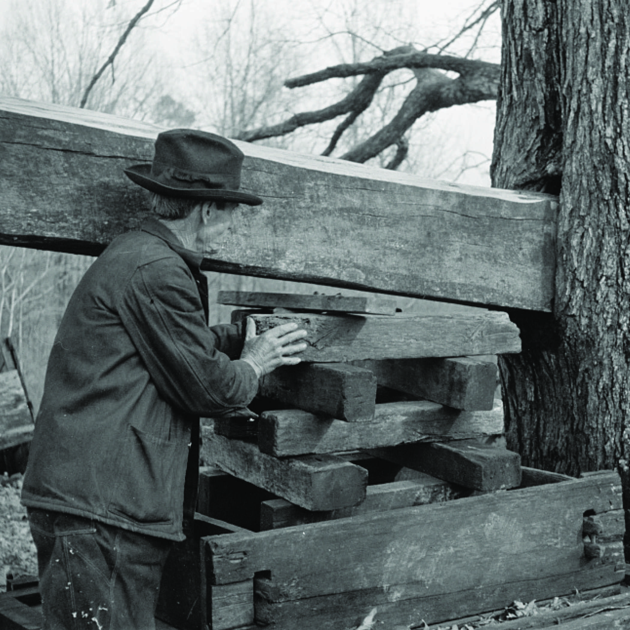 a man in the 1930s operating a cider press