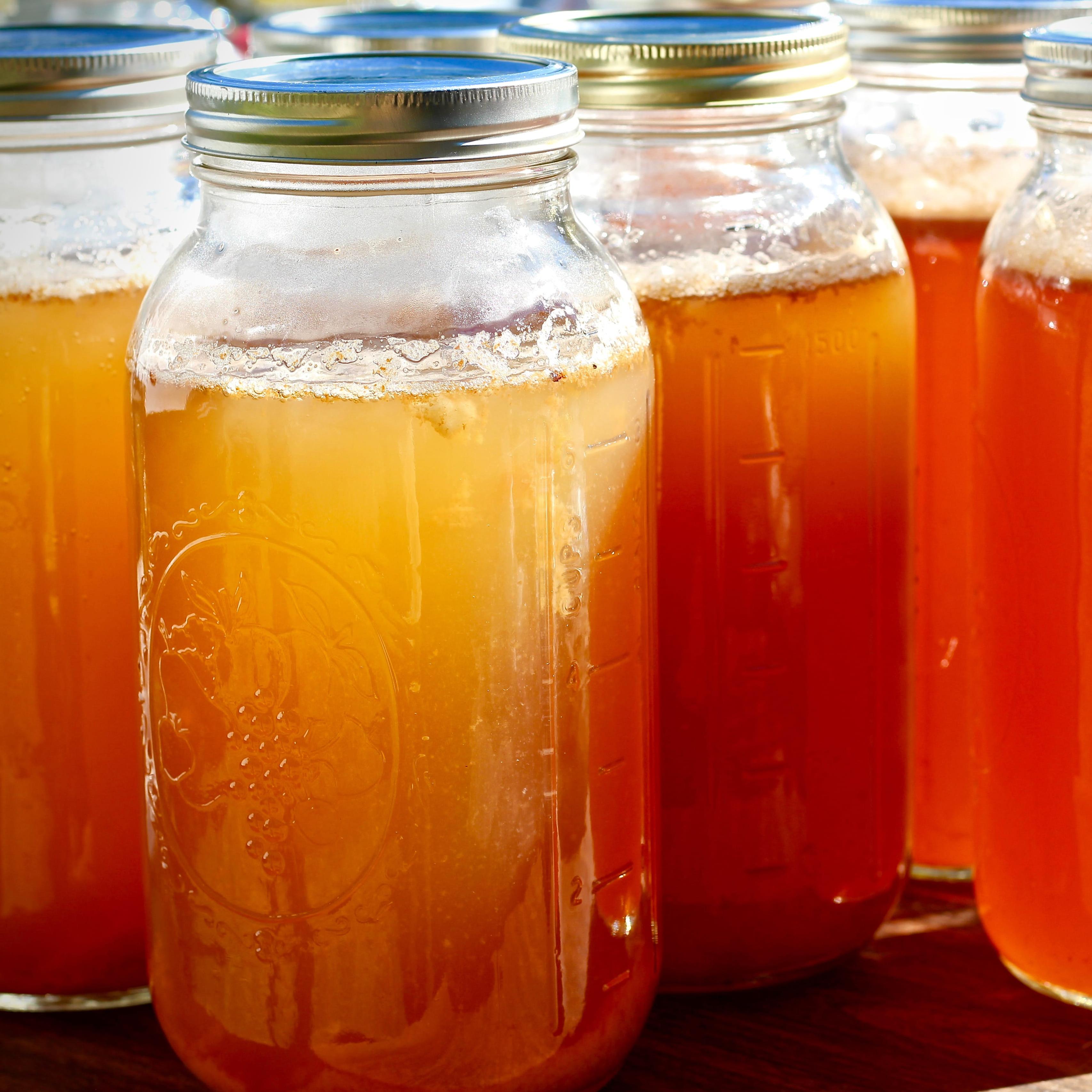 canning jars filled with apple cider