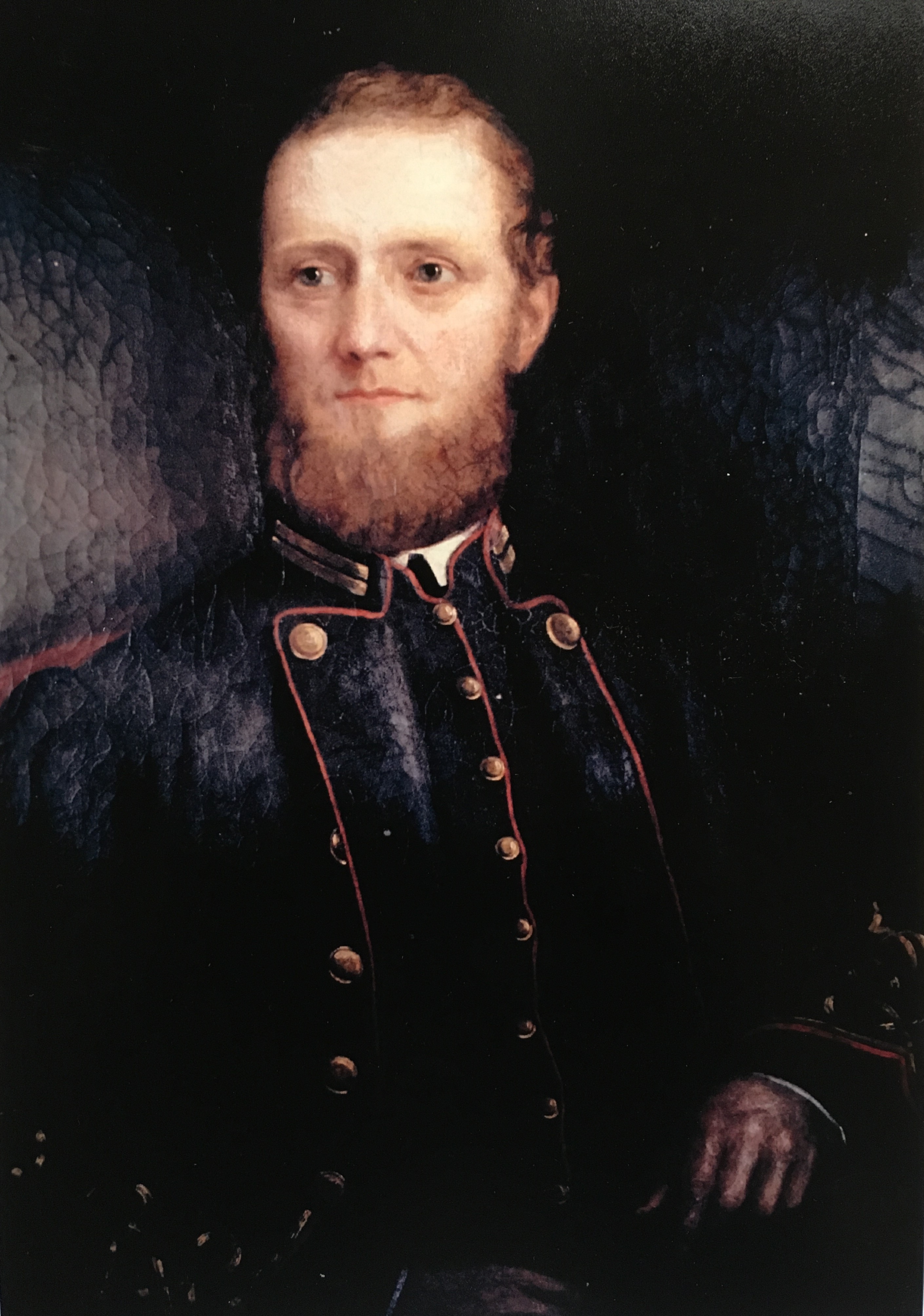 Portrait of a man with a beard wearing a confederate uniform.