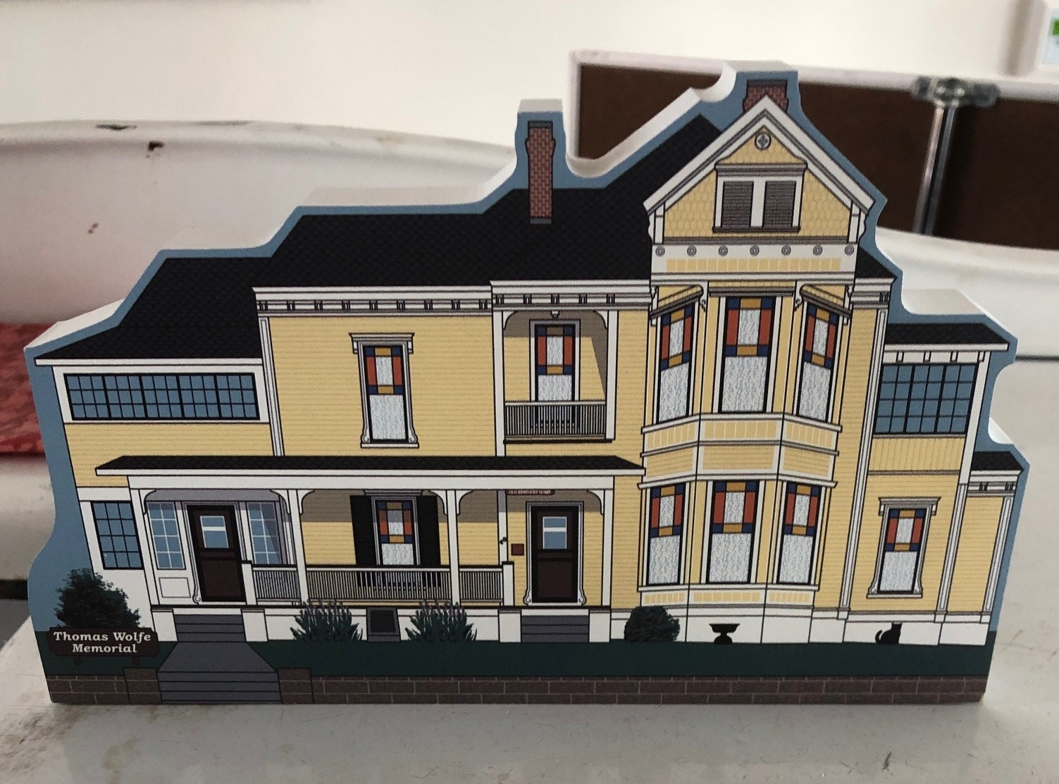 Wooden cutout of the Old Kentucky Home. Approximately 4 inches by 6 inches by 1 inch. Can stand up on its own