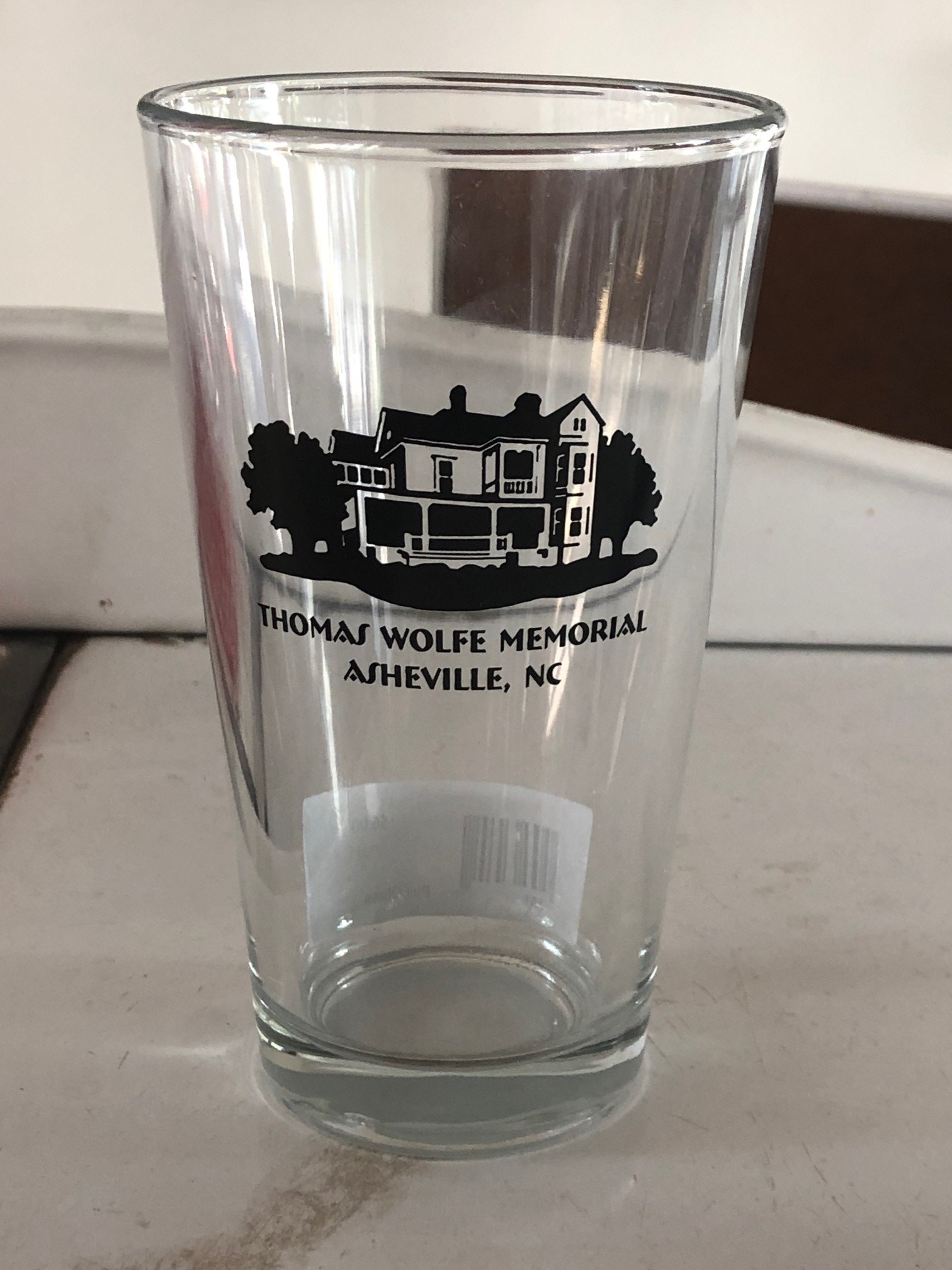 Clear glass pint glass with the Old Kentucky Home in black and the words Thomas Wolfe Memorial Asheville NC