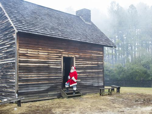 Santa in front of old house