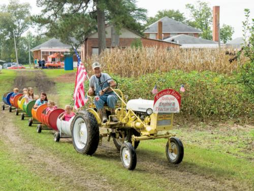 children on tractor pulled train