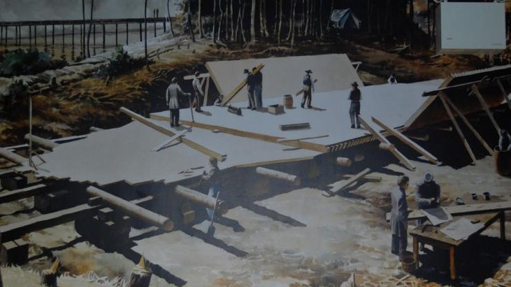 people rebuilding ship