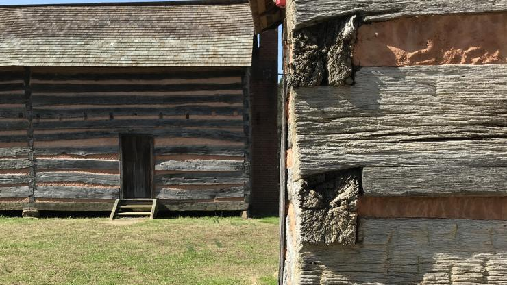 view of Polk's reconstructed childhood log cabin