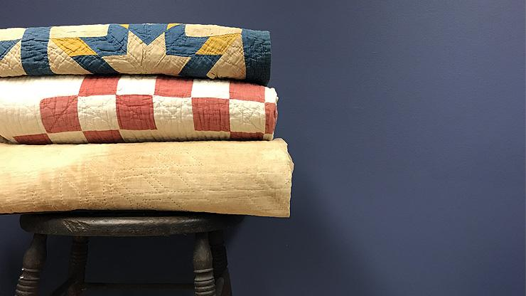 image of stack of quilts
