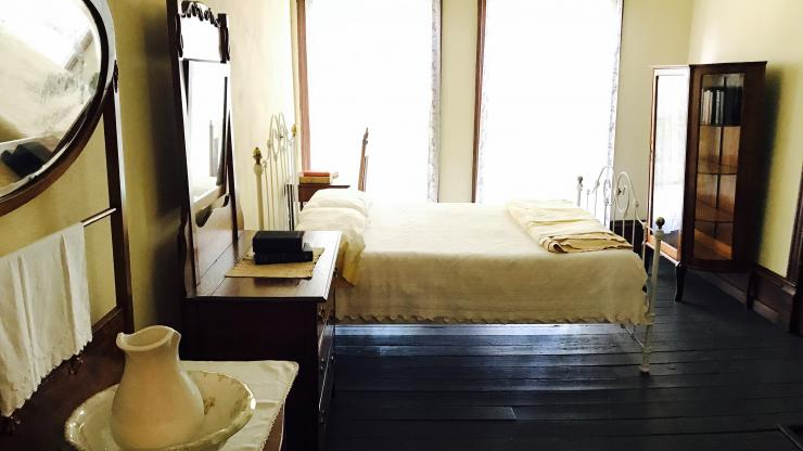 Boarder's bedroom inside the Old Kentucky Home