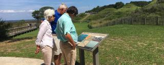 visitors read a wayside
