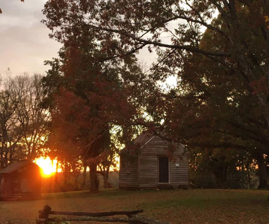 sunset over the grounds of House in the Horseshoe