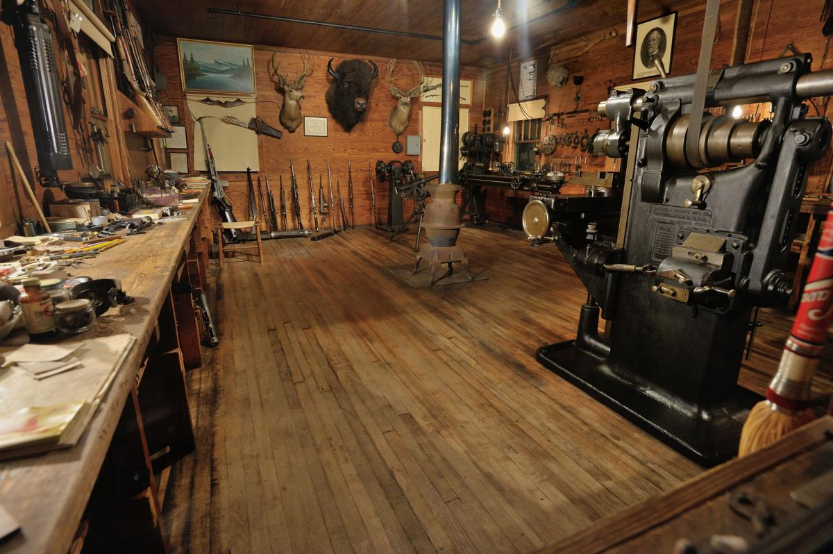 "The workshop of David ""Carbine"" Williams. The one-room workshop includes nearly 3,000 artifacts. A myriad of tools, drawings, guns and other items remain a testament to Williams's drive and ingenuity."