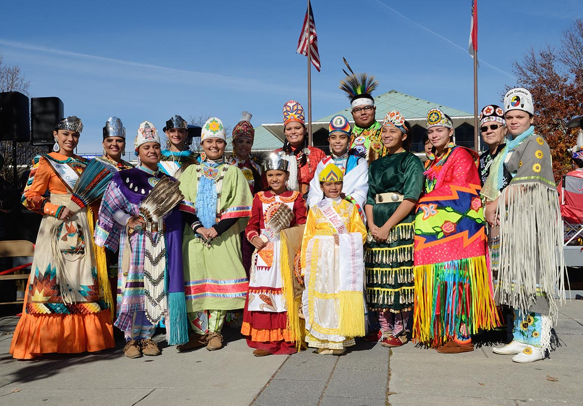 A group of American Indians from different tribes stand together in solidarity