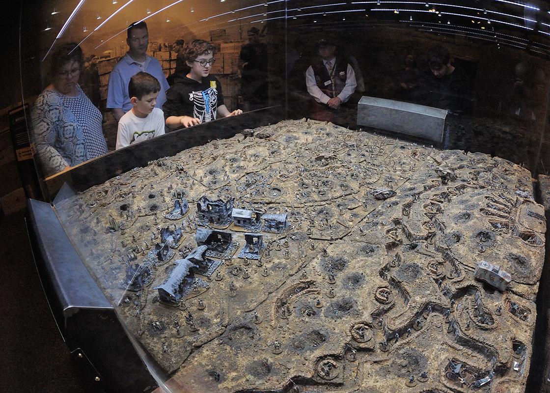 """Visitors exploring the exhibit, """"North Carolina & World War I."""""""