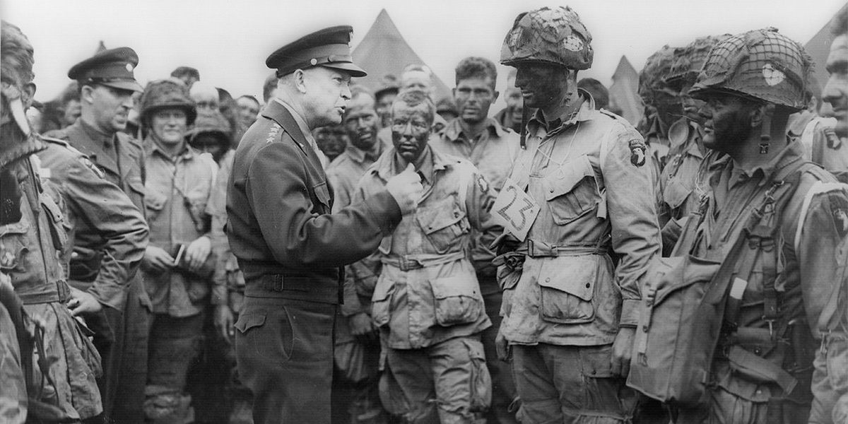 "Gen. Dwight D. Eisenhower gives the order of the Day. ""Full victory-nothing else"" to paratroopers in England, just before they board their airplanes to participate in the first assault in the invasion of the continent of Europe. June 6, 1944."