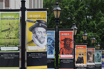 "Banners for the exhibit, ""The Story of North Carolina,"" along Bicentennial Plaza"