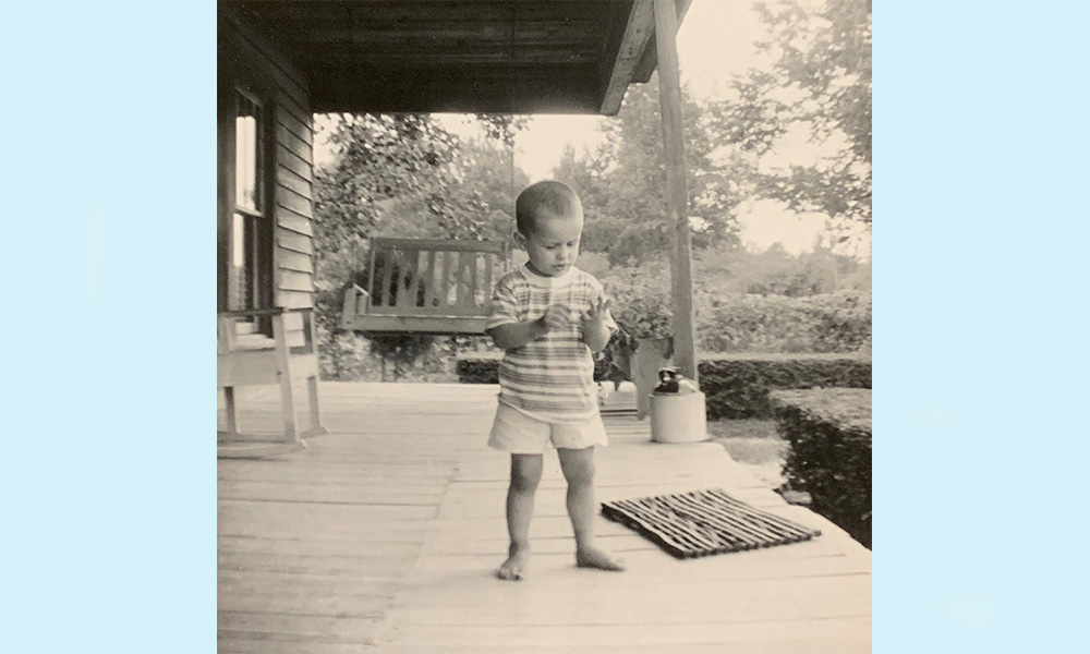 Our decorative arts curator, Michael Ausbon, is pictured here as a young boy in 1970 on his grandmother's front porch, with a swinging bench in the background.