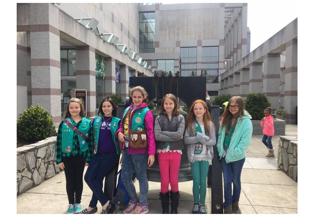 Girl Scouts outside of the North Carolina Museum of History building