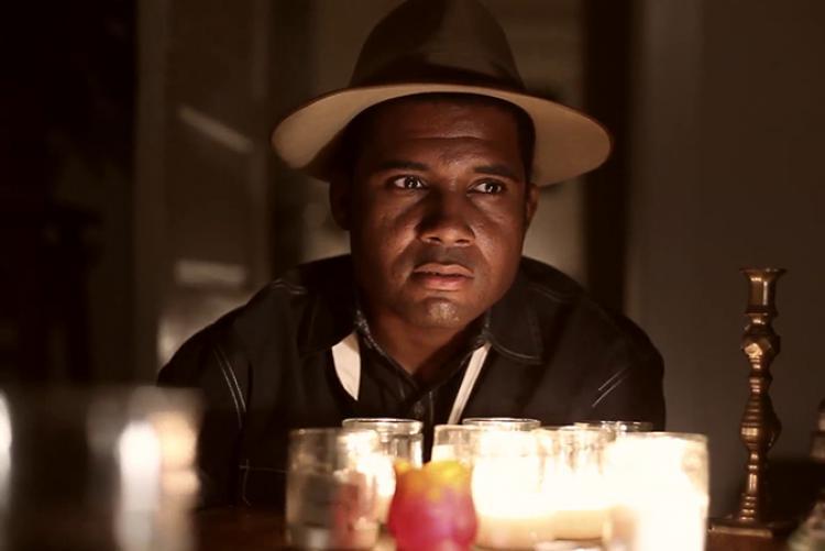 African American actor, Mike Wiley, posing as Emmett Till