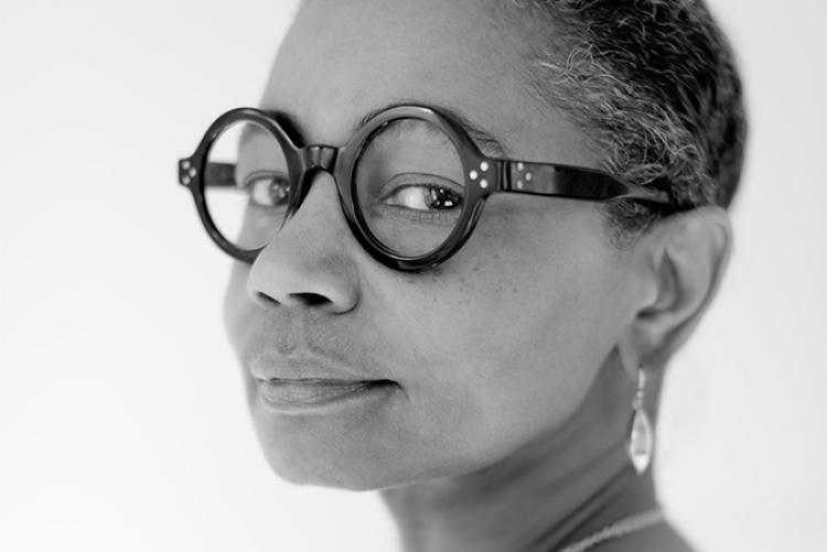 Contemporary artist Precious Lovell in a black-and-white photograph