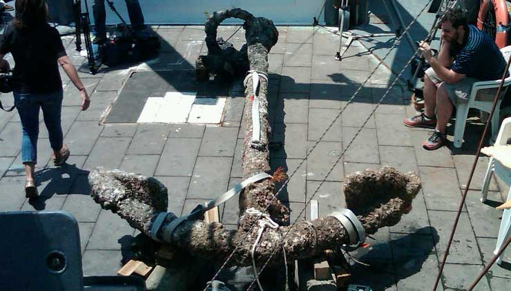 One of the Queen Anne's Revenge's anchors is brought to the deck of the Dan Moore off the coast of Beaufort, NC.