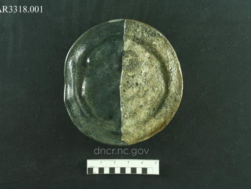Partially cleaned pewter plate from the QAR site.