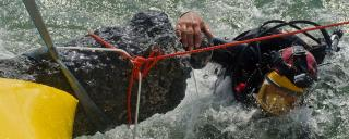 A diver helps raise an artifact of the Queen Anne's Revenge from the ocean floor.